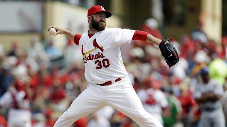 FILE - In this March 18, 2013, file photo, St. Louis Cardinals relief pitcher Jason Motte throw during the ninth inning of an exhibition spring training baseball game against the New York Mets in Jupiter, Fla. Motte probably will start the season on the disabled because of a mild muscle flexor strain in his pitching arm. The Cardinals said Saturday, March 23, that the right-hander had stopped throwing following the results of an MRI a day earlier. (AP Photo/Jeff Roberson, File)