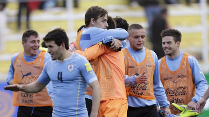 Players of Uruguay celebrate after their victory against Bolivia during their 2018 World Cup qualifying soccer match in La Paz
