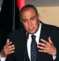 Libyan government spokesman Nasser al-Manaa holds a press conference in Tripoli on May 8, 2012 after former Libyan rebels angry over unpaid stipends opened fire on the headquarters of the interim government. Al-Manaa said the defence minister was negotiating with the fighters