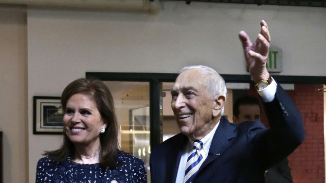 Sen. Frank Lautenberg, the oldest member of the U.S. Senate, stands with his wife Bonnie Englebardt Lautenberg, as he waves to a gathering Friday, Feb. 15, 2013, in his hometown of Paterson, N.J., where he announced plans to retire at the end of his current term. The 89-year-old says he'll fight for gun control, against global warming and press to ensure working families are not left behind.   (AP Photo/Mel Evans)