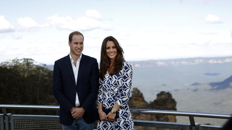 "Britain's Prince William and his wife Catherine, the Duchess of Cambridge, pose for pictures during their visit to the ""Three Sisters"" rock formation in the Blue Mountains town of Katoomba"