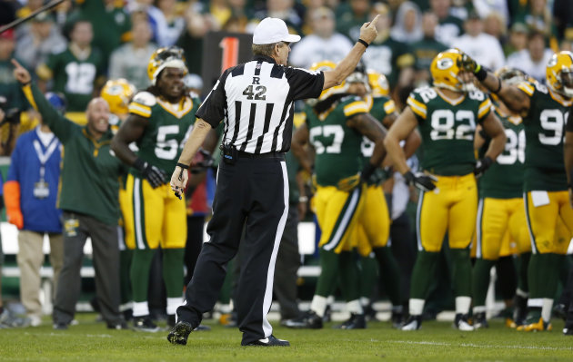 Referee Jeff Triplette signals New Orleans Saints&#39; possession, after a video review, during the second half of the Saints&#39; NFL football game against the Green Bay Packers on Sunday, Sept. 30, 2012, in Green Bay, Wis. Saints&#39; Darren Sproles appeared to fumble a kickoff but officials ruled that he was down by contact. Replays showed that the ball clearly came out but the Packers were out of replay challenges, leaving Packers fans screaming at the officials for the second week in a row. (AP Photo/Tom Lynn)