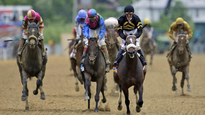 Jockey Gary Stevens celebrates aboard Oxbow after winning the 138th Preakness Stakes horse race at Pimlico Race Course, Saturday, May 18, 2013, in Baltimore. Itsmyluckyday, third from left, ridden by John Velazquez, finished second; and Mylute, left, ridden by Rosie Napravnik finished third. (AP Photo/Patrick Semansky)