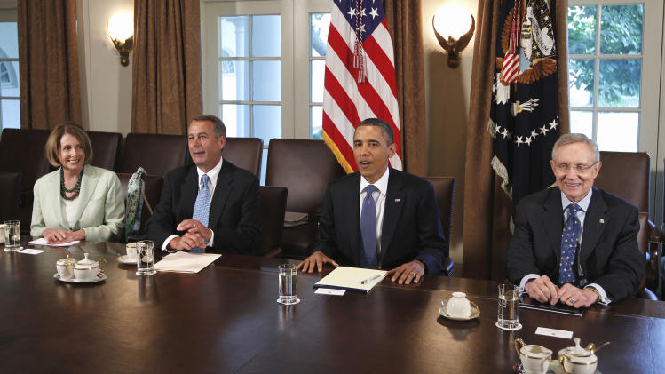 President Barack Obama meets with Republican and Democratic leaders regarding the debt ceiling, Monday, July 11, 2011, in the Cabinet Room of the White House in Washington. From left are, House Minority Leader Nancy Pelosi of Calif.,  House Speaker John Boehner of Ohio, the president, and Senate Majority Leader Harry Reid of Nev.  (AP Photo/Charles Dharapak)
