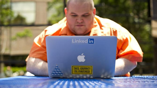 FILE - This Tuesday, May 7, 2013, file photo, Greg Leffler, a site reliability engineer at LinkedIn, works outside his company's Mountain View, Calif., headquarters. LinkedIn Corp. reports quarterly financial results after the market closes on Thursday, Aug. 1, 2013. (AP Photo/Noah Berger, File)