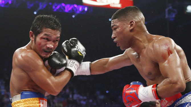 Yuriorkis Gamboa, from Miami, Fla., right, connects with a right to the chin of Michael Farenas, from the Philippines, during their WBA interim super featherweight title fight Saturday, Dec. 8, 2012, in Las Vegas.(AP Photo/Eric Jamison)
