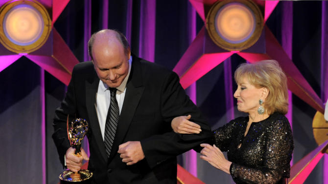Barbara Walters, right, presents the lifetime achievement award to Bill Geddie onstage at the 39th Annual Daytime Emmy Awards at the Beverly Hilton Hotel on Saturday, June 23, 2012 in Beverly Hills, Calif. (Photo by Chris Pizzello/Invision/AP)