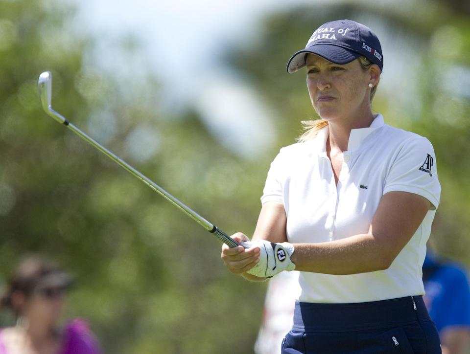 Cristie Kerr prepares to hit her drive off the 16th tee in the third round of the LPGA LOTTE Championship golf tournament at Ko Olina Golf Club, Friday, April 20, 2012, in Kapolei, Hawaii. (AP Photo/Eugene Tanner)