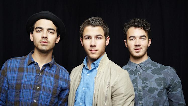 FILE - This April 9, 2013 file photo shows, from left, Joe Jonas, Nick Jonas and Kevin Jonas, of American pop rock band The Jonas Brothers in New York. The band announced Tuesday, Oct. 19, 2013, they're ending their highly successful run. The news comes after the brothers abruptly canceled their tour over creative differences earlier this month. (Photo by Dan Hallman/Invision/AP, File)