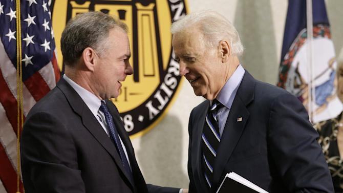 Vice President Joe Biden shakes hands with Sen. Tim Kaine, D-Va., left, at Virginia Commonwealth University in Richmond, Va., Friday, Jan. 25, 2013, after a round table conference on gun violence.  The panelists included officials who worked on the aftermath of the Virginia Tech shootings. (AP Photo/Steve Helber)
