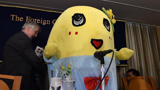 "Pear fairy ""Funassyi"", the unofficial mascot of Funabashi City, appears at the Foreign Correspondents' Club in Tokyo on March 5, 2015"
