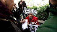 Protesters call for democracy and greater media freedom outside the headquarters of Nanfang Media in Guangzhou, on January 9, 2013. A Chinese weekly newspaper at the centre of rare public protests against government censorship will publish as usual on Thursday, a senior reporter said, following reports of a deal to end the row