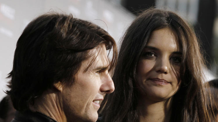 "FILE - In this Monday, March 28, 2011 file photo, cast member Katie Holmes, right, and Tom Cruise arrive at the premiere of ""The Kennedys"" at The Academy of Motion Pictures Arts and Sciences in Beverly Hills, Calif. Cruise and Homes are calling it quits after five years of marriage. Holmes' attorney Jonathan Wolfe said Friday June 29, 2012 that the couple is divorcing, but called it a private matter for the family. (AP Photo/Matt Sayles)"