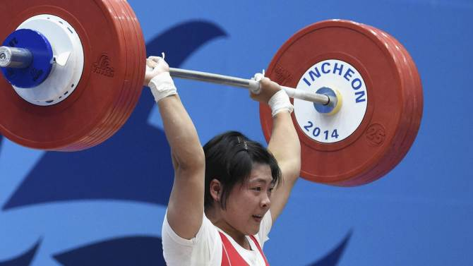 North Korea's Ri Jong Hwa competes to win gold in the women's 58kg weightlifting competition during the 17th Asian Games in Incheon