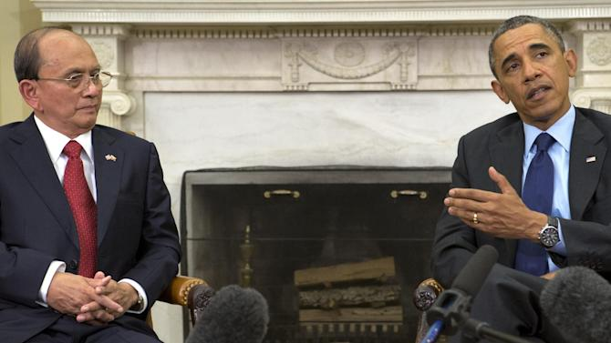 President Barack Obama gestures toward Myanmar's President Thein Sein during their meeting in the Oval Office of the White House in Washington, Monday, May 20, 2013. Thein Sein is the first Myanmar president to be welcomed to the White House in almost 47 years. (AP Photo/Jacquelyn Martin)