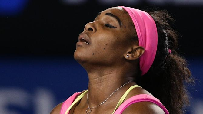 Serena Williams of the U.S. reacts as she plays Maria Sharapova of Russia during the women's singles final at the Australian Open tennis championship in Melbourne, Australia, Saturday, Jan. 31, 2015. (AP Photo/Rob Griffith)