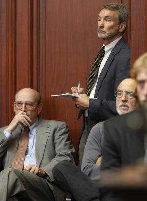 Allen Gilbert, director of the Vermont Chapter of the American Civil Liberties Union, standing, listens during Supreme Court arguments on Wednesday, June 22, 2011 in Montpelier, Vt. The Vermont Supreme Court heard arguments on an electronic privacy case that could help determine how much access police can have to a suspect's computer and other electronic devices. (AP Photo/Toby Talbot)
