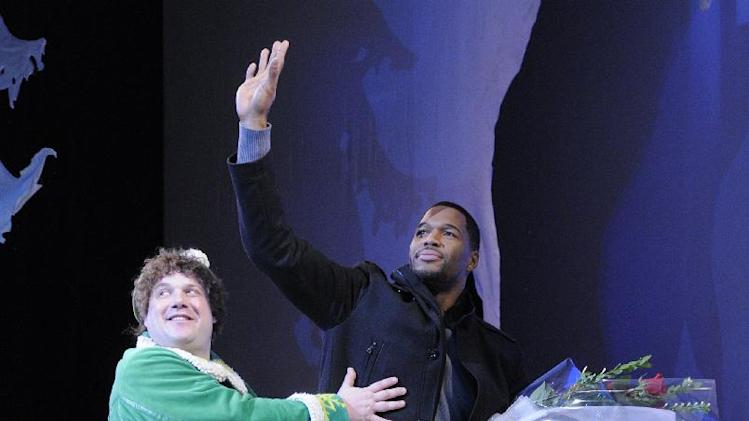 "This image released by ABC shows former NFL player Michael Strahan, right, and Jordan Gelber during a curtain call for the matinee show of the musical ""Elf,"" Wednesday, Dec. 5, 2012 in New York. Strahan, a co-host on the morning show ""Live! with Kelly and Michael,"" made his Broadway debut Wednesday playing three roles in the Christmas-themed musical.  (AP Photo/Disney-ABC, Lorenzo Bevilaqua)"