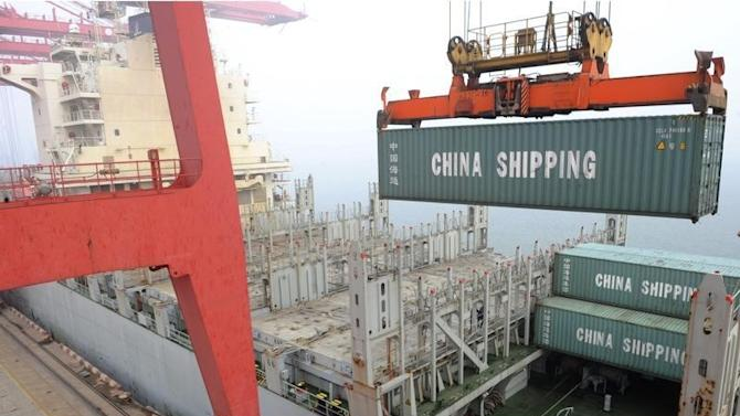 Shipping container is lifted by a crane at a port in Lianyungang