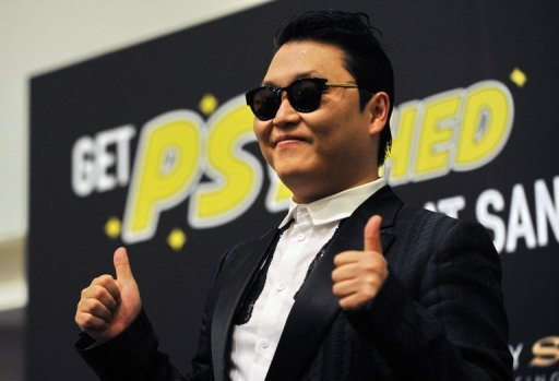 "South Korean pop sensation Psy, pictured during a press conference before a public appearance in Singapore, on December 1, 2012. Psy's ""Gangnam Style"" video was galloping towards the one-billion-view mark on YouTube Friday, a fresh milestone in the enduring global craze for the S.Korean rapper and his horse-riding dance."