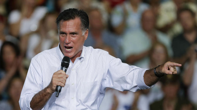Republican presidential candidate and former Massachusetts Gov. Mitt Romney speaks to supporters during a rally Friday, Sept. 21, 2012, in Las Vegas. Romney campaigned in Nevada as aides released a 2011 federal income tax return showing he and his wife, Ann, paid $1.94 million in federal taxes last year on income of $13.7 million. (AP Photo/Julie Jacobson)