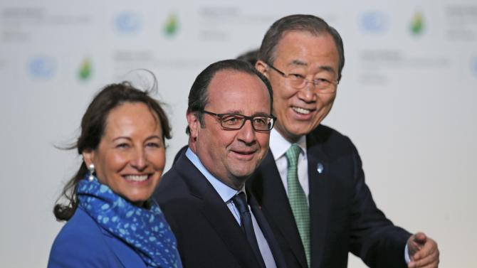 French President Hollande, French Ecology Minister Royal and United Nations Secretary General Ki-moon wait to welcome head of states and governments as they arrive for the opening day of the COP21 at Le Bourget, near Paris