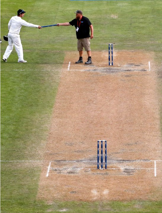 New Zealand's Rutherford is handed a stump by a groundsman at the end of the first test against England at the University Oval in Dunedin