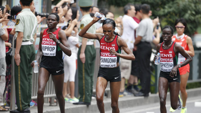 Kenyan athletes compete during the women's marathon at the 15th IAAF Championships in Beijing