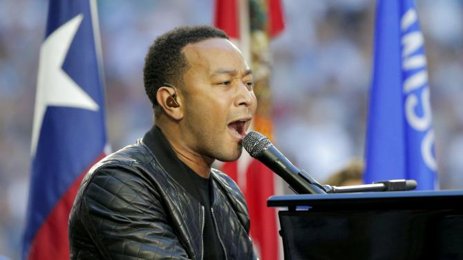 """Singer John Legend performs """"America the Beautiful"""" before the start of the NFL Super Bowl XLIX football game between the Seattle Seahawks and the New England Patriots in Glendale"""
