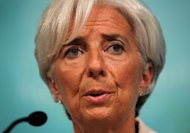 IMF Managing Director Christine Lagarde speaks during a news conference at the IMF headquarters in Washington, DC. The International Monetary Fund warned Tuesday that the Obama administration could be slicing the deficit too fast for the weak US economy as it pared its growth forecast