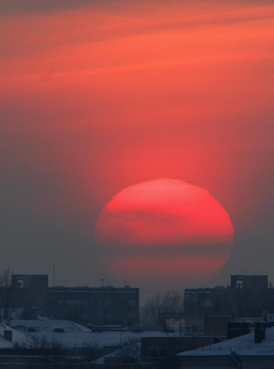 The sun sets over Vilnius , Lithuania, Monday, Feb. 06, 2012.The air temperature -17 degrees Celsius (1,4 degrees Fahrenheit). (AP Photo/Mindaugas Kulbis)  LITHUANIA OUT