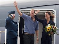 FILE - In this July 4, 2011 file photo, Prince William and Kate, the Duke and Duchess of Cambridge wave to the crowd as they board the plane in Summerside, Prince Edward Island. The couple will arrive Friday, July 8, in California, a state that in the years since Princess Diana's death has passed three laws intended to curb paparazzi abuses. (AP Photo/The Canadian Press, Andrew Vaughan)