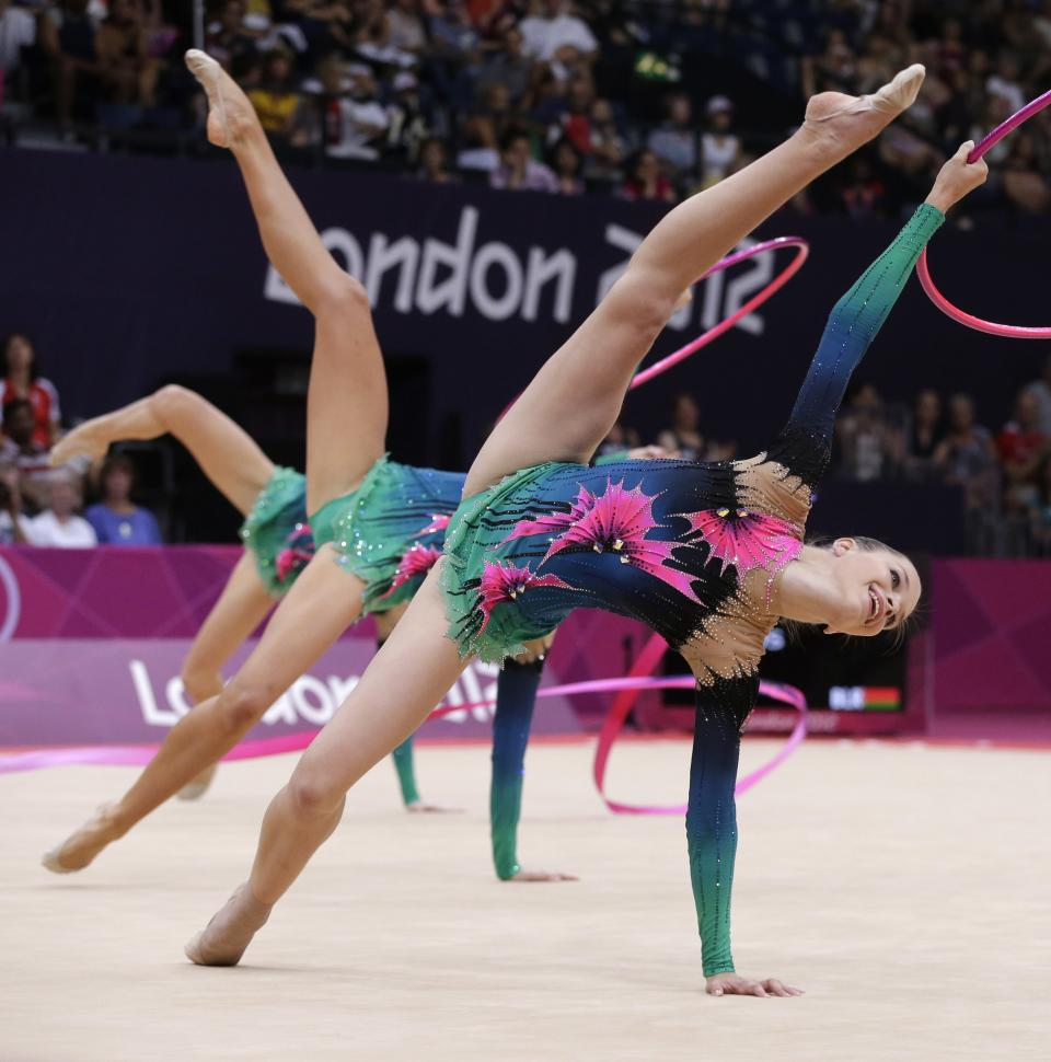 The team from Belarus performs during the rhythmic gymnastics group all-around qualifications at the 2012 Summer Olympics, Friday, Aug. 10, 2012, in London. (AP Photo/Julie Jacobson)