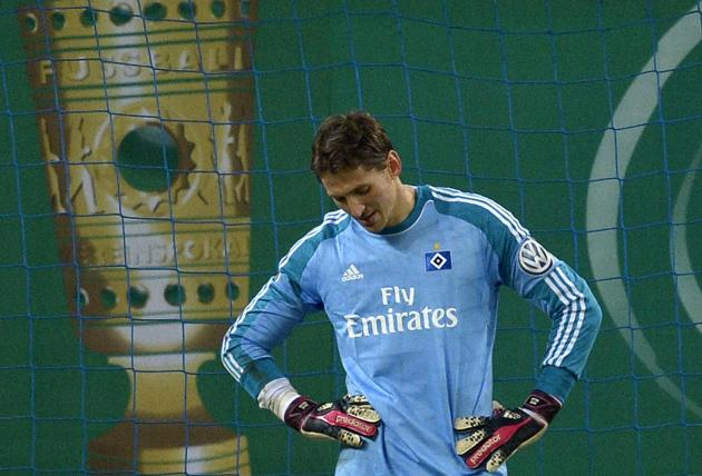 Hamburger SV's goalie Adler reacts during the quarter-final German soccer cup (DFB-Pokal) match against Bayern Munich in Hamburg