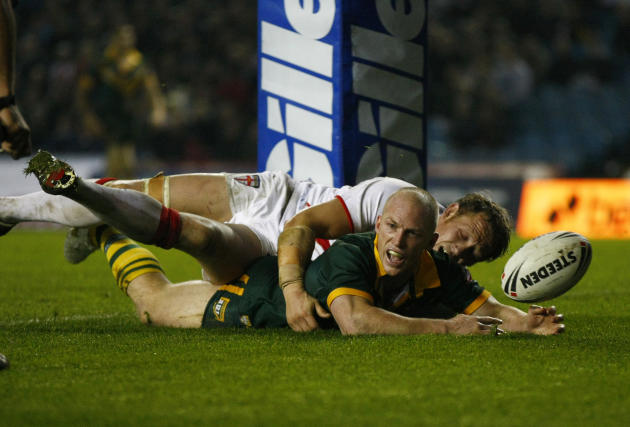 Australia's Darren Lockyer, left, dives over despite the tackle of England's Ben Westwood to score a try during the four nations rugby league final at Elland Road, Leeds, England, Saturday Nov. 19, 20