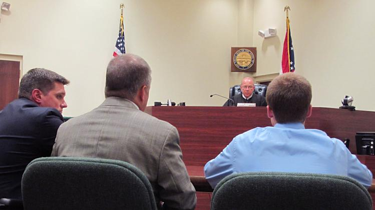 In a Tuesday, July 31 2012 photo, Warren County Juvenile Court Judge Mike Powell warns 17-year-old Ohio high school student Tyler Pagenstecher, right, of the consequences of admitting guilt at his first hearing in Lebanon, Ohio. Pagenstecher pleaded guilty to drug-trafficking charges in juvenile court.  Police say he played a major role in a drug ring that sold as much as $20,000 worth of high-grade marijuana a month to fellow students at two high schools. He could be ordered held until he turns 21.(AP Photo/Amanda Lee Myers)