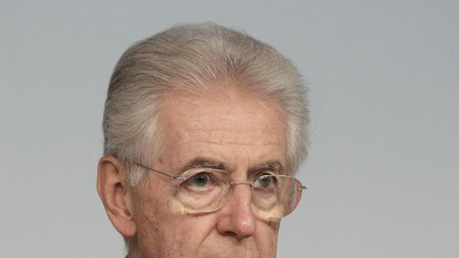 Italian Premier Mario Monti listens to a question during a press conference at the end of a cabinet meeting at Chigi Palace government's office in Rome, Thursday, Dec. 6, 2012. Concerns over the stability of the Italian government grew on Thursday after Silvio Berlusconi's party withdrew its support, threatening to bring a premature end to Premier Mario Monti's ambitious reforms program. Berlusconi's center-right PDL party abstained from a confidence vote in the Senate on Thursday. Though Monti's government of unelected technocrats won the vote by 127 to 17, investors fear the move heralds a period of political uncertainty in the run-up to planned elections next year. (AP Photo / Riccardo De Luca)