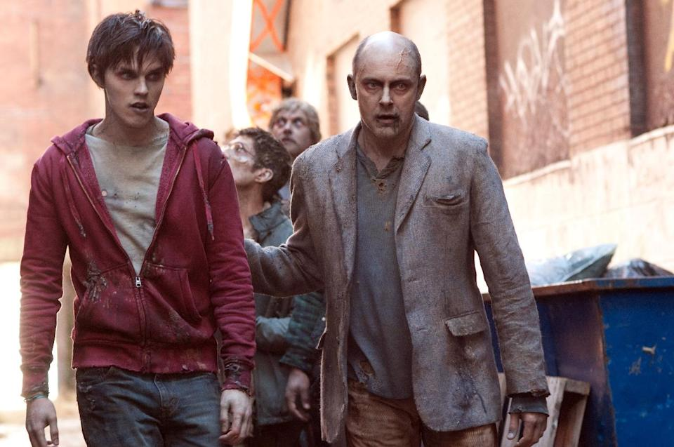 "This film image released by Summit Entertainment shows Rob Corddry, right, and Nicholas Hoult in a scene from ""Warm Bodies."" (AP Photo/Summit Entertainment, Jonathan Wenk)"