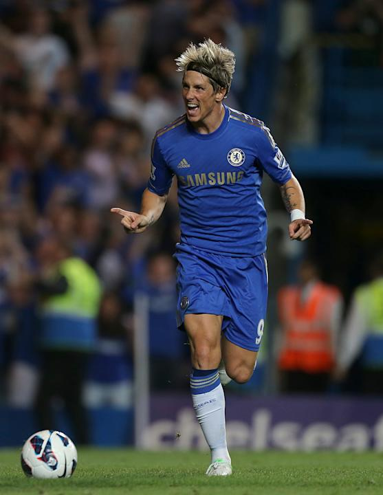 Chelsea's Fernando Torres celebrates scoring their third goal of the game