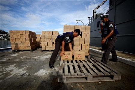 Navy personnel arrange boxes containing disaster relief items in Acapulco