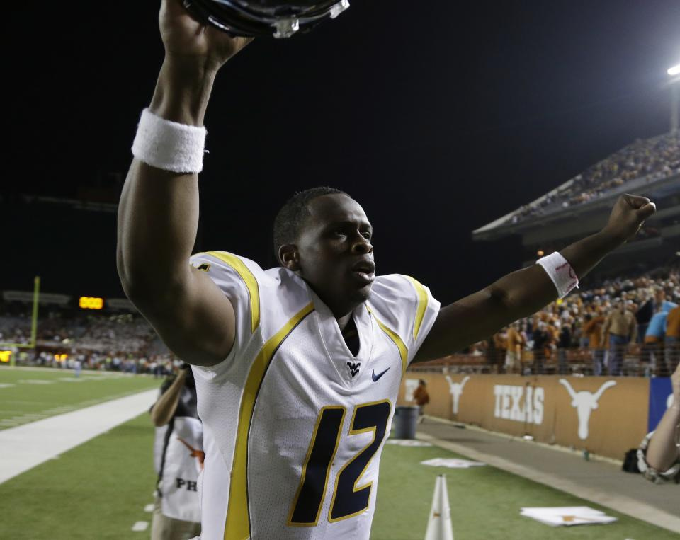 West Virginia quarterback Geno Smith runs off the field following the team's win over Texas in an NCAA college football game on Saturday, Oct. 6, 2012, in Austin, Texas. West Virginia won 48-45. (AP Photo/Eric Gay)