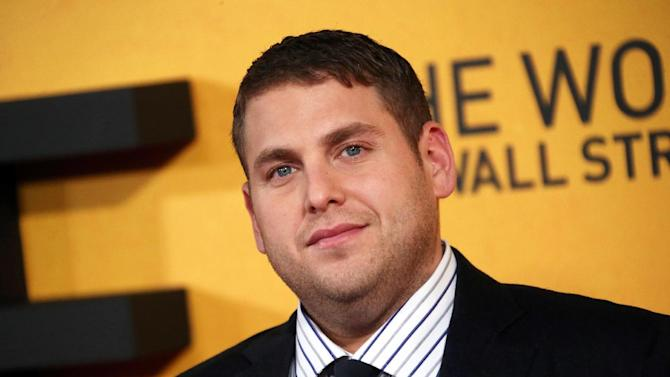 """FILE - This Jan. 9, 2014 file photo shows U.S actor Jonah Hill at the UK Premiere of """"The Wolf Of Wall Street,"""" at a Leicester Square cinema in central London. Hill has apologized for shouting a homophobic slur at a paparazzo in an encounter caught on video. A video posted Tuesday, June 3, by TMZ shows a photographer pestering Hill, who responded with expletives and an anti-gay expression. On """"The Howard Stern Show"""" on Tuesday, the 30-year-old actor acknowledged that he said """"a disgusting word."""" Hill said the word """"does not at all reflect how I feel about any group of people."""" He said that he's been a gay-rights activist """"from the day I was born."""" Earlier this year, Hill promoted a Human Rights Campaign effort opposing anti-gay laws in Russia ahead of the Winter Olympics. Hill said he had been harassed by the photographer, claiming he said """"hurtful things about my family, really hurtful things about me personally."""" (Photo by Joel Ryan/Invision/AP, File)"""