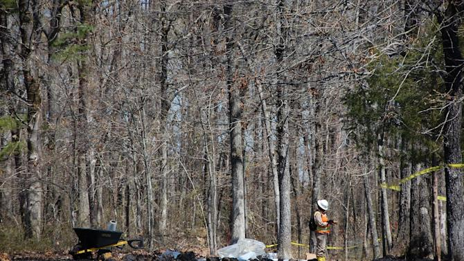 Workers clean up oil in Mayflower, Ark., on Monday, April 1, 2013, days after a pipeline ruptured and spewed oil over lawns and roadways. (AP Photo/Jeannie Nuss)