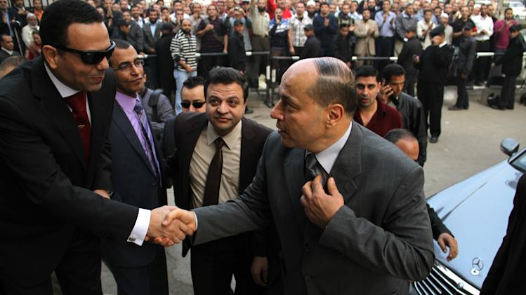"""Newly appointed Egyptian prosecutor general, Talaat Abdullah, arrives for work on his first day in office after being appointed by President Mohammed Morsi in sweeping edicts announced Thursday temporarily giving Morsi  near-absolute power over the executive, judicial and legislative branches of government, in Cairo, Egypt, Saturday, Nov. 24, 2012. Morsi fired the controversial former prosecutor general and created """"revolutionary"""" judicial bodies to put Mubarak and some of his top aides on trial a second time for the killings of protesters playing to widespread discontent with the judiciary. (AP Photo/Mohammed Abu Zeid)"""