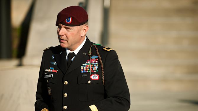 FILE - In this Tuesday, Jan. 22, 2013, file photo, Army Brig. Gen. Jeffrey A. Sinclair leaves a Fort Bragg, N.C., courthouse after he deferred entering a plea at his arraignment on charges of fraud, forcible sodomy, coercion and inappropriate relationships. Sinclair, 51, faces a maximum sentence of life in prison at a court-martial scheduled to begin March 3. (AP Photo/The Fayetteville Observer, Andrew Craft, File)