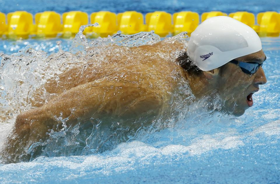 United States' Michael Phelps competes in a men's 200-meter butterfly swimming heat at the Aquatics Centre in the Olympic Park during the 2012 Summer Olympics in London, Monday, July 30, 2012. (AP Photo/Daniel Ochoa De Olza)