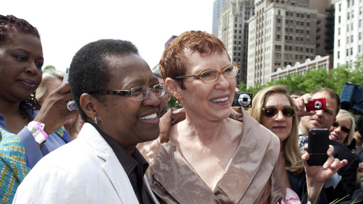 In this June 2011 photo provided by Starbelly Studios in Chicago, Vernita Gray, left, and Patricia Ewert smile during their civil union ceremony at Millennium Park in Chicago. U.S. District Judge Thomas Durkin on Monday, Nov. 25, 2013, ordered the Cook County clerk to issue an expedited marriage license to Gray and Ewert before the state's gay marriage law takes effect in June 2014. Gray is terminally ill. (AP Photo/Courtesy of Starbelly Studios, Timmy Samuel)