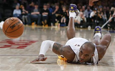 Los Angeles Lakers Kobe Bryant dives for a loose ball during their NBA game against the Chicago Bulls in Los Angeles