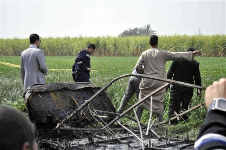 Rescue officials examine the wreckage of a hot air balloon that crashed in Luxor