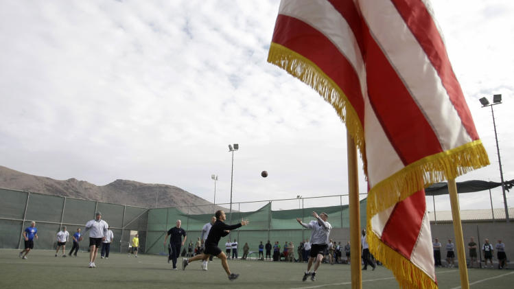U.S. soldiers, part of NATO forces, play ultimate football to mark the Thanksgiving at the U.S.-led coalition base in Kabul, Afghanistan, Thursday, Nov. 22, 2012.(AP Photo/Musadeq Sadeq)
